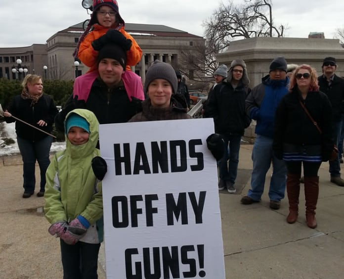 A family from Burnsville attended a rally at the State Capitol to oppose upcoming hearings on gun control legislation. Photo by nick coleman