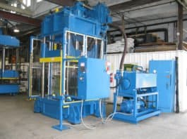 """400 ton down-acting 48"""" x 58"""" hydraulic press refurbished by Icon for a composite armor manufacturer."""