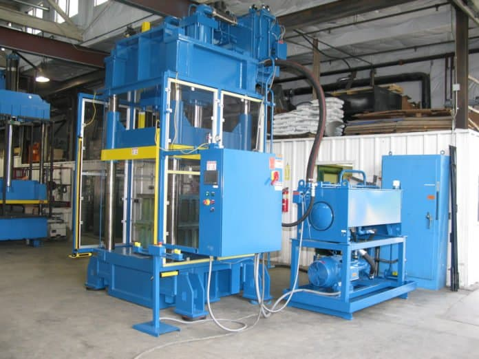 "400 ton down-acting 48"" x 58"" hydraulic press refurbished by Icon for a composite armor manufacturer."